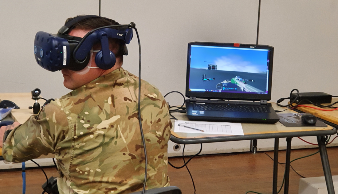 Using a VR headset, a forward observer views the effects of smoke dropped by mortars. Image courtesy Minerva Training & Simulation.